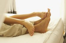 Close-up of couple's feet at luxury resort